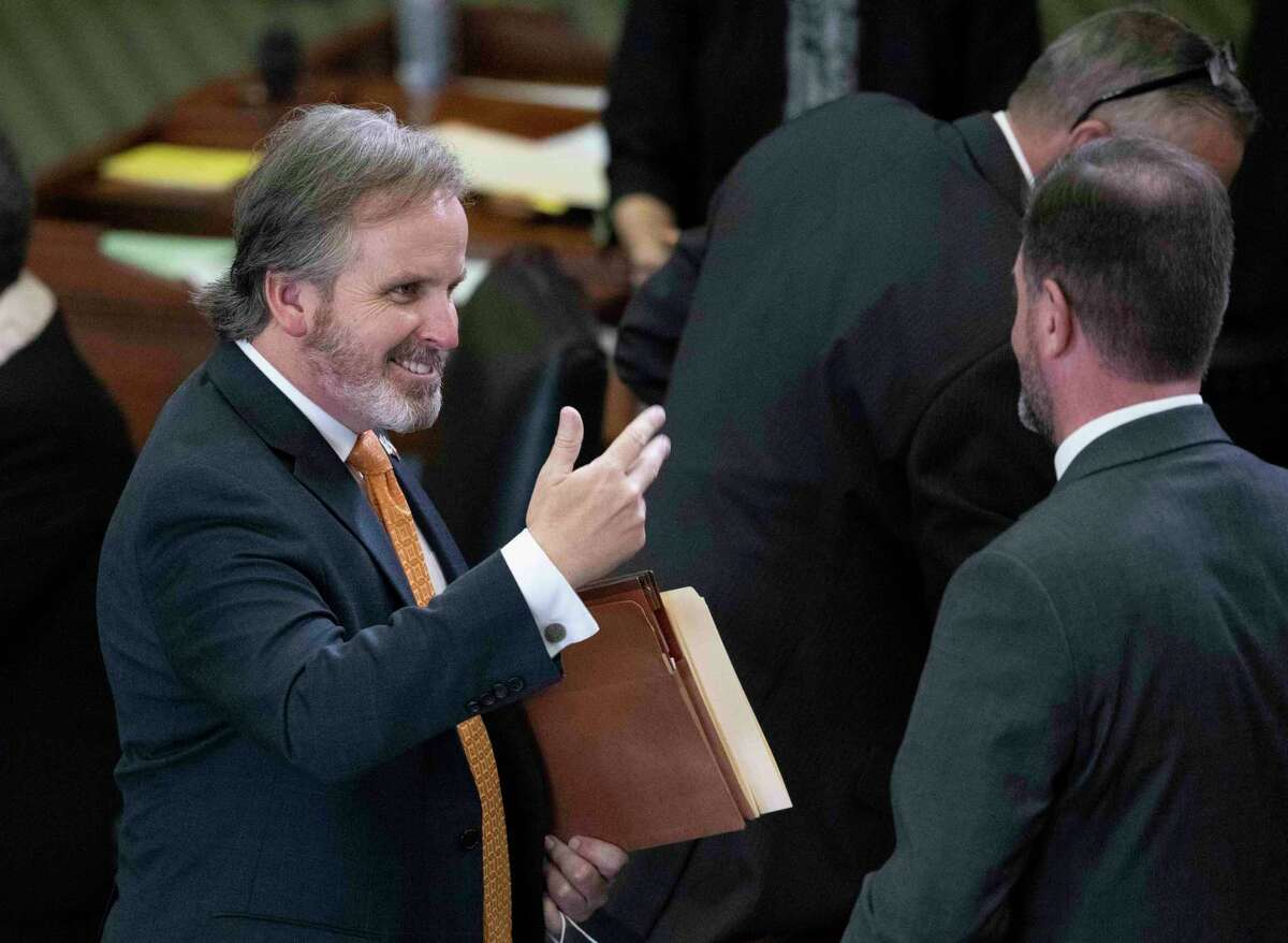 """Sen. Bryan Hughes, R-Mineola, left, speaks with another senator during the regular legislative session. SB 3, filed by state Sen. Bryan Hughes during the special session, would strip out upcoming requirements that students learn white supremacy is """"morally wrong"""" and study particular writings by women and people of color."""