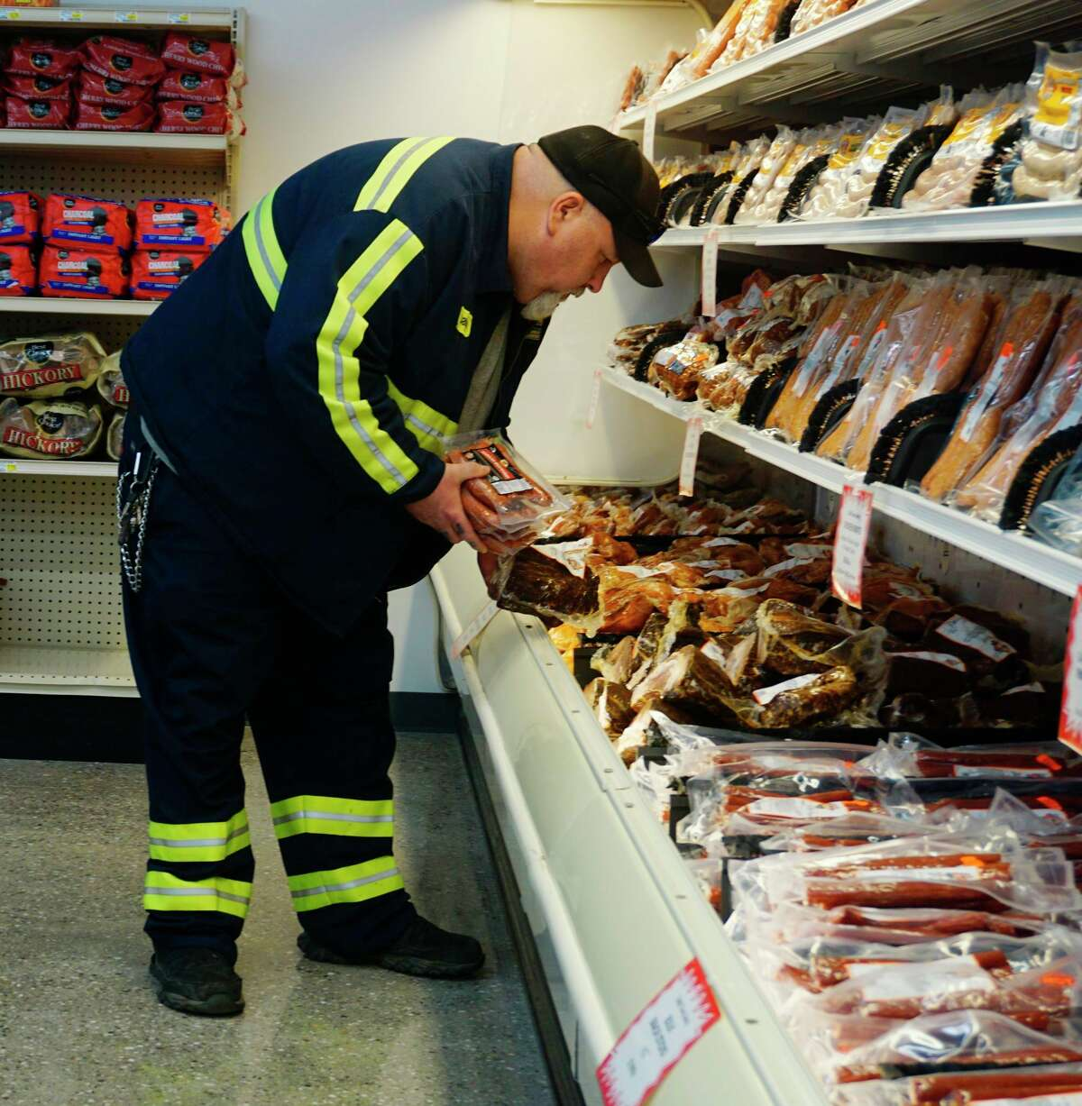 A shopper looks over the meat section at the new Ebels General Store in Reed City. (Herald Review photo/Joe Judd)