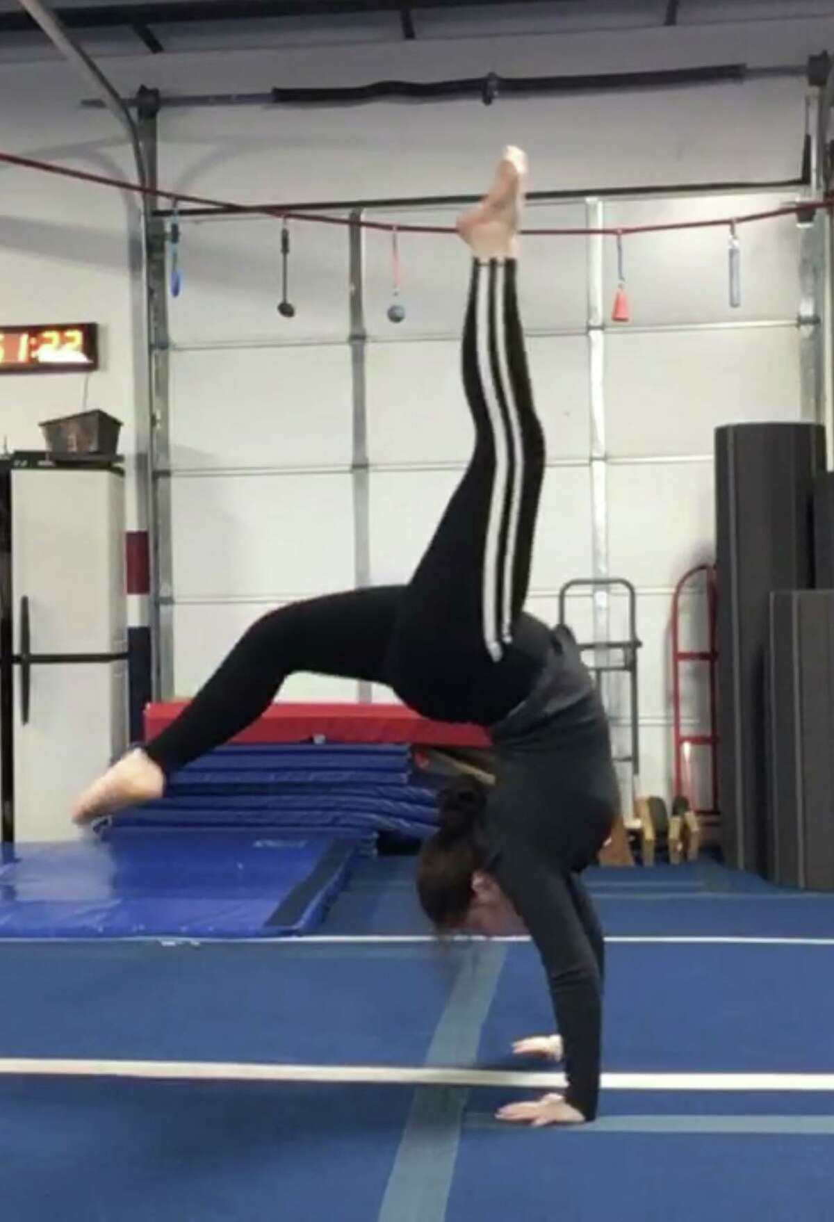 Missouri City resident Cheyenna Becker lost her dad in Iraq in 2007 and has been able to take gymnastics classes with financial support from The Folder Flag Foundation, an organization that helps Gold Star families.