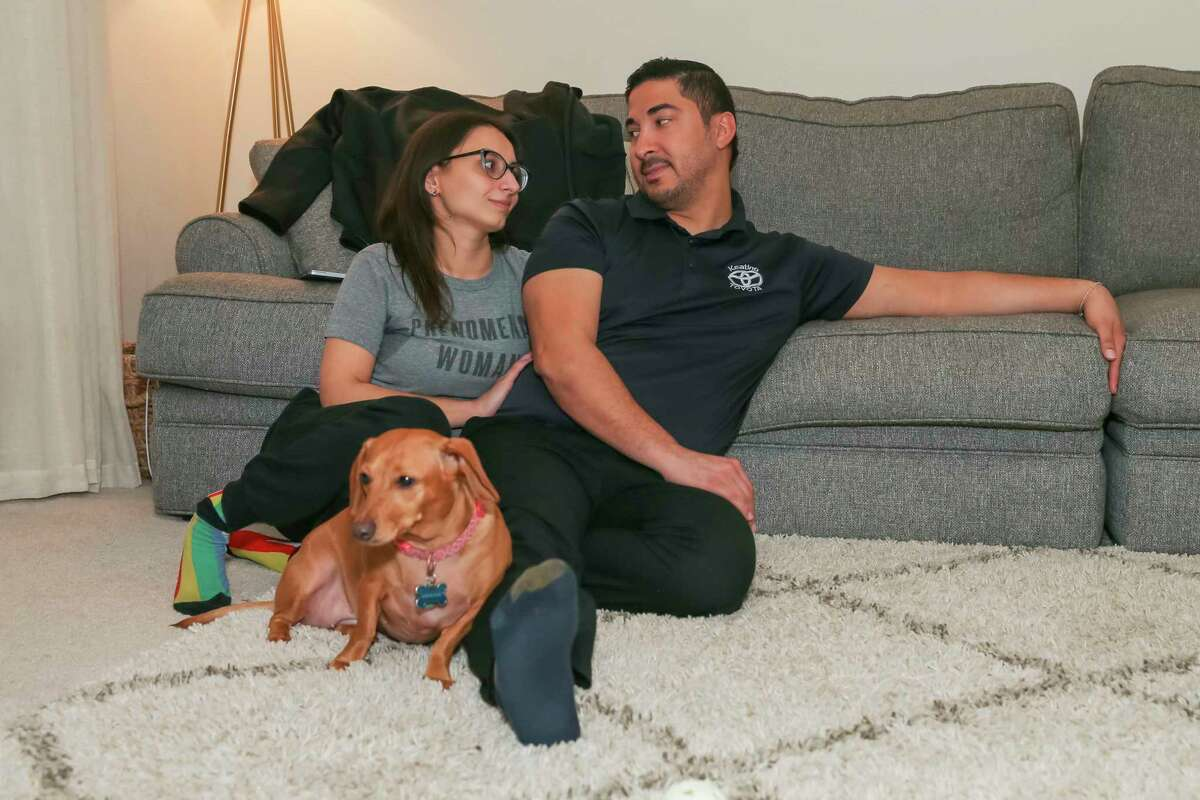 Kelley Perkins and Al Ruiz relax at their home in Clear Lake City, a suburb of Houston. Perkins, an ICU nurse and Ruiz, a finance manger at a car dealership, discuss their thoughts on wearing masks and vaccinations on July 8, 2021 in Houston, TX.