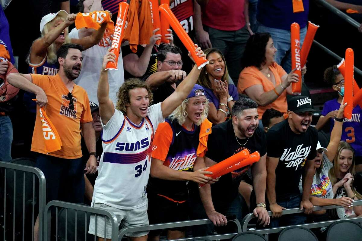 Phoenix Suns fans cheer on their team during the second half of Game 1 of basketball's NBA Finals against the Milwaukee Bucks, Tuesday, July 6, 2021, in Phoenix. The Suns defeated the Bucks 118-105. (AP Photo/Ross D. Franklin)