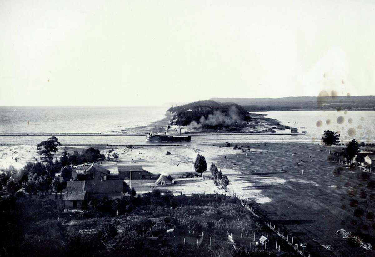 This photo shows a view of Portage Lake Channel circa 1900. (Manistee County Historical Museum photo)