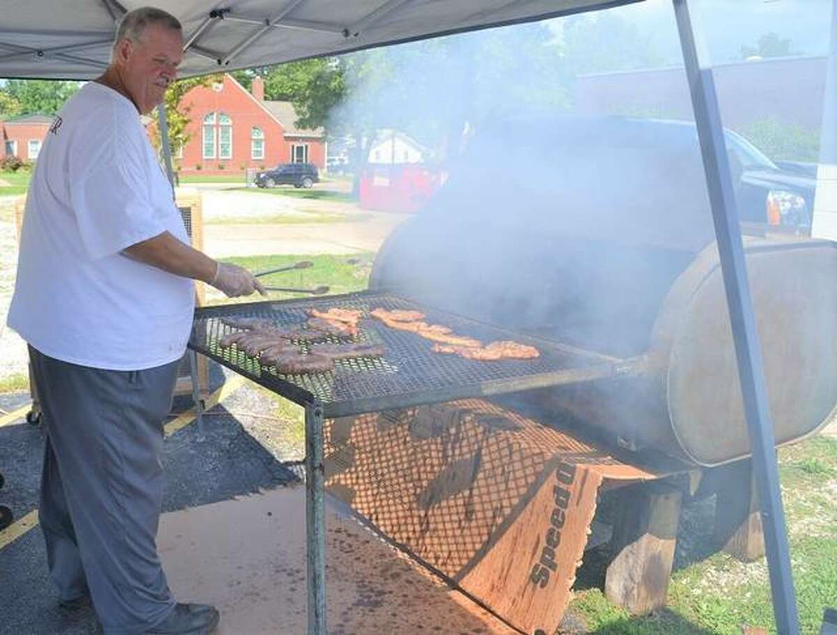 Terry Steward, Men's Ministry President, mans the grill for the Main Street United Methodist Men's summer barbecues. Canceled last year by COVID-19, the barbecues return again Saturday, July 17.
