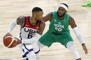 Damian Lillard of the United States is guarded by Josh Okogieof Nigeria during an exhibition game at Michelob ULTRA Arena ahead of the Tokyo Olympic Games on July 10, 2021 in Las Vegas, Nevada.