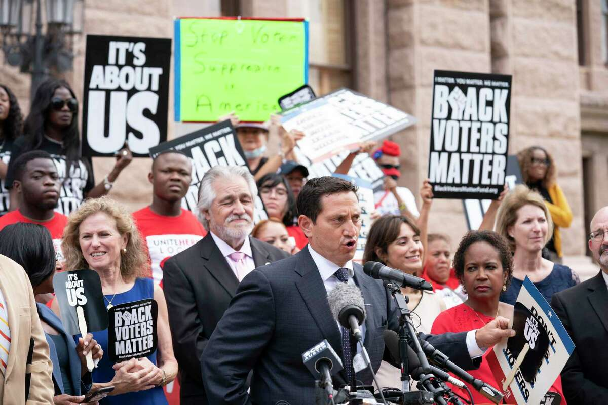A coalition of voting rights groups including Black Voters Matter and the Texas Right to Vote Coalition rally at the Capitol to decry voter supression bills being advocated by Gov. Greg Abbott. At the mic is State Rep. Trey Martinez-Fischer, D-San Antonio.