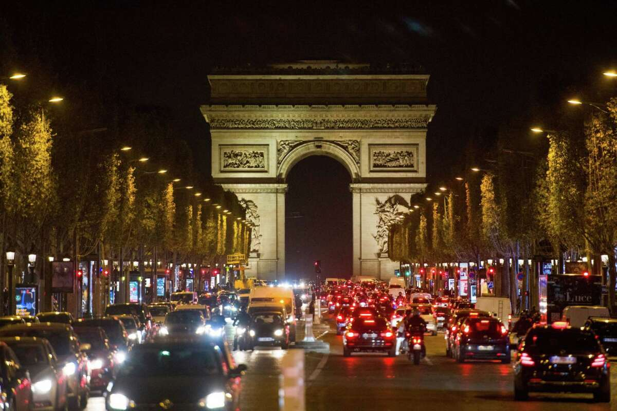 Traffic on the Champs Elysees in Paris on Thursday, Oct. 29, 2020.