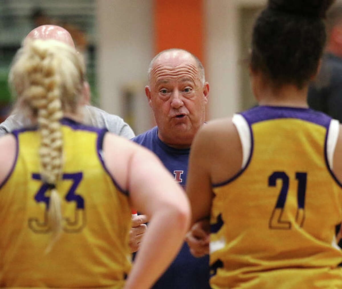 CM coach Mike Arbuthnot instructs his team during a timeout in a June 29 girls basketball game against the host Tigers in Edwardsville. CM is coming off a 16-1 season.