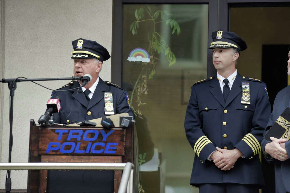 Troy Police Deputy Chief Dan DeWolf, left, speaks at a ceremony to mark the retirement of Troy Police Chief Brian Owens, right, on Monday, July 12, 2021, in Troy, N.Y. Deputy Chief DeWolf will be sworn in as the new police chief on Thursday. (Paul Buckowski/Times Union)