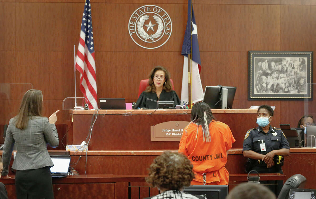 Assistant District Attorney Andrea Beall (l-r) addresses The 174th District Judge Hazel B. Jones as she looks at Theresa Balboa, who is charged with capital murder in the death of 5-year-old Samuel Olson, made her first court appearance in the new case Monday, July 12, 2021, in Houston.