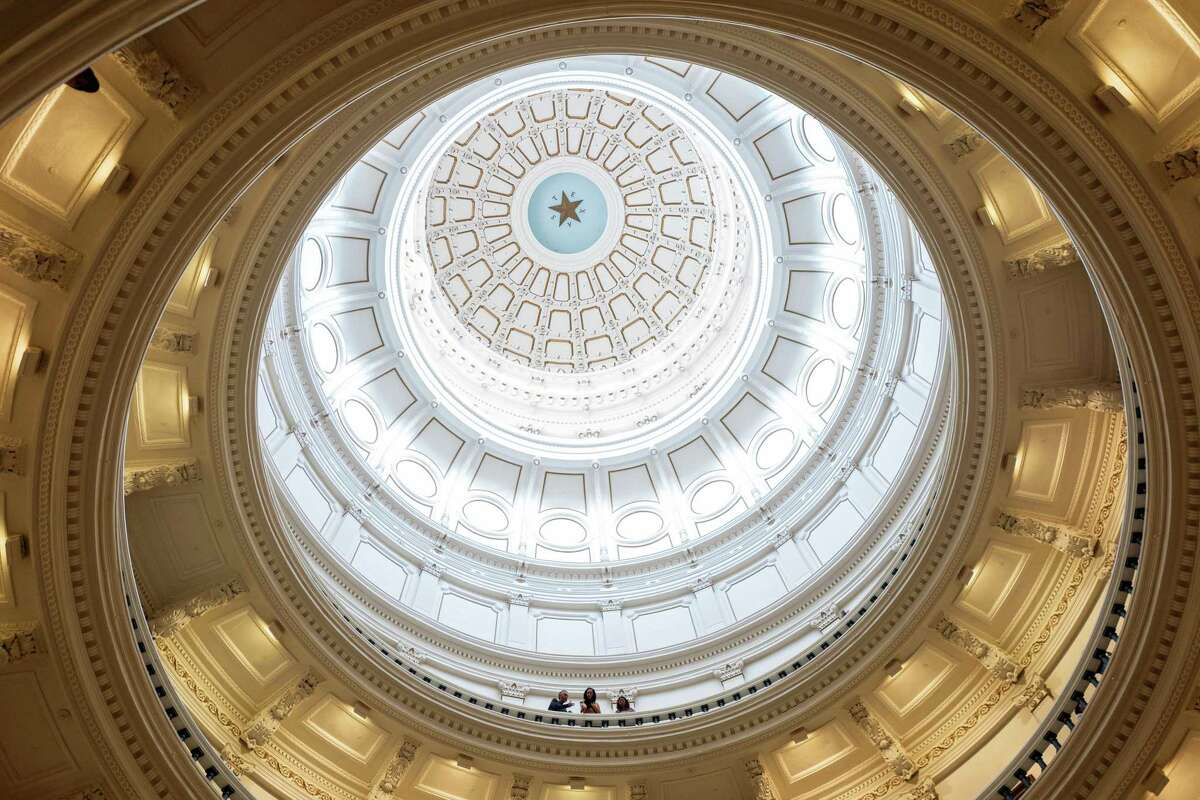 AUSTIN, TX - JULY 08: People look over a railing in the rotunda of the Texas State Capitol on the first day of the 87th Legislature's special session on July 8, 2021 in Austin, Texas. Republican Gov. Greg Abbott called the legislature into a special session, asking lawmakers to prioritize his agenda items that include overhauling the state's voting laws, bail reform, border security, social media censorship, and critical race theory. (Photo by Tamir Kalifa/Getty Images)