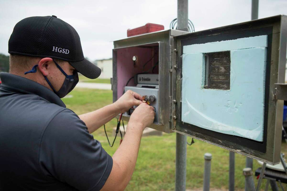 Field inspector Robert Loveland sets up GPS monitoring site P013 that delivers data on land subsidence, or the sinking of land surface, to the Harris-Galveston Subsidence District, Tuesday, April 13, 2021 in The Woodlands. The site is one of 256 monitoring sites throughout the region. The data is used to track how groundwater usage affects subsidence and its impacts, such as flooding.