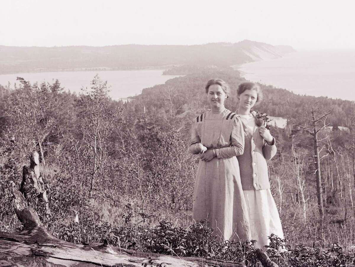 Anna Edwards and Adel Bernstein on a hill looking south over Lower Herring Lake about 1910. (Courtesy Photo)
