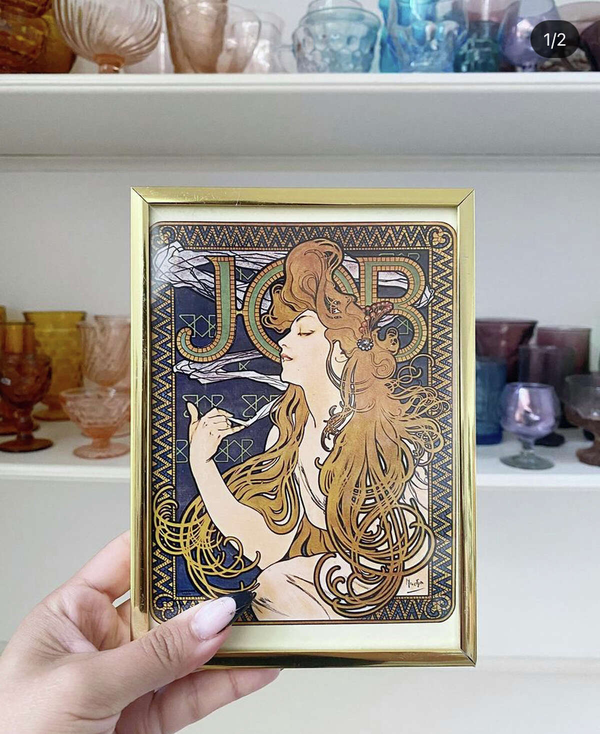 Rose Vintage Rose Vintage, run by Delisa and Joshua Morales, has been operating through Instagram @rosevintage.satx for one year. The shop always dazzles with colorful glassware, home furnishings, and art (like this framed art deco print by Alphonse Mucha).