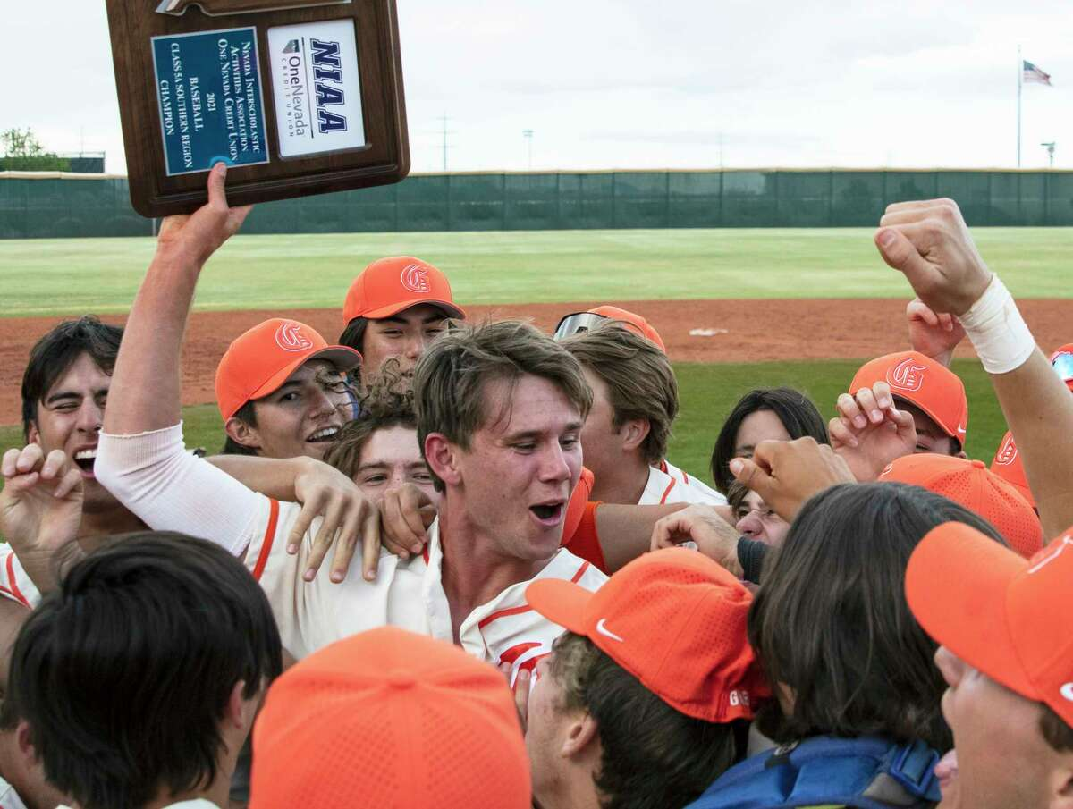 Bishop Gorman High School's right fielder Tyler Whitaker joins his teammates as they celebrate their victory against Palo Verde in the Class 5A regional baseball championship game at Bishop Gorman on Saturday, May 22, 2021, in Las Vegas.