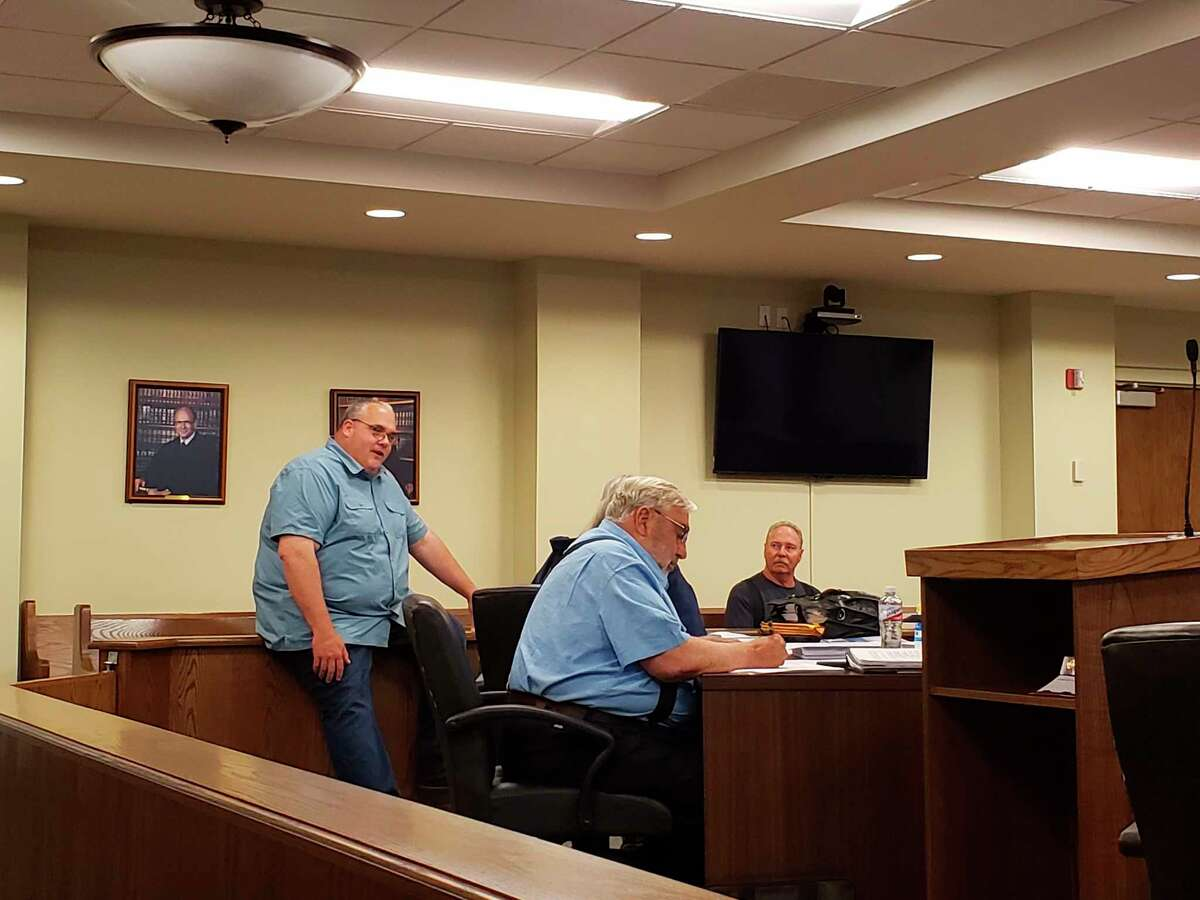 Planning Commission Chairman Bill Renn and Building and Zoning Director Jeff Smith talk before this week's meeting, where the planners made further changes to the still in-development solar ordinance. (Robert Creenan/Huron Daily Tribune)