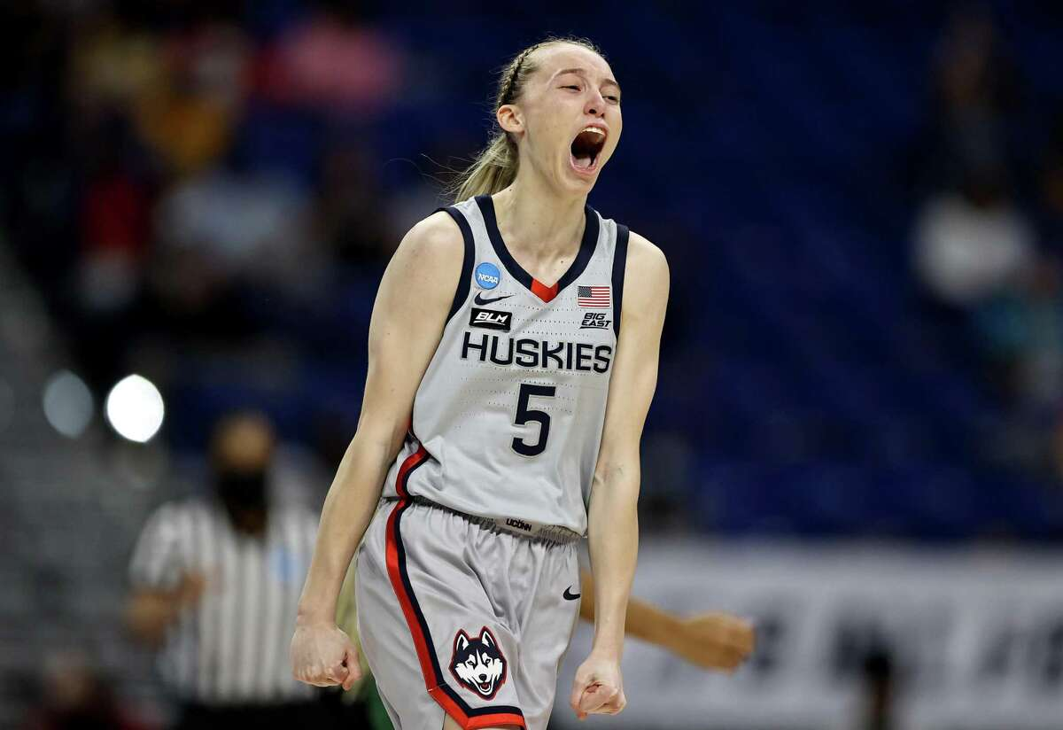 SAN ANTONIO, TEXAS - MARCH 29: Paige Bueckers #5 of the UConn Huskies celebrates her three point basket in the first quarter against the Baylor Lady Bears during the Elite Eight round of the NCAA Women's Basketball Tournament at the Alamodome on March 29, 2021 in San Antonio, Texas. (Photo by Elsa/Getty Images) ***BESTPIX***