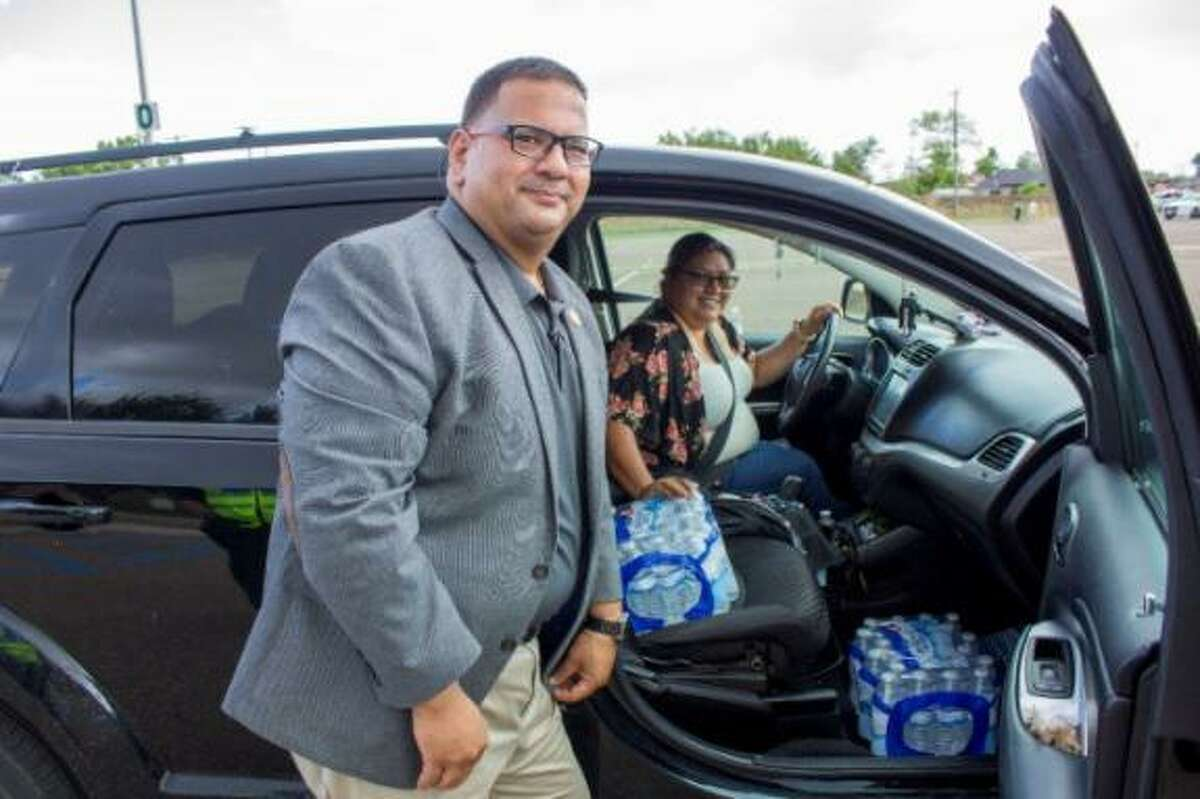 Laredo College employees distribute bottled water to Laredoans amid boil water notice