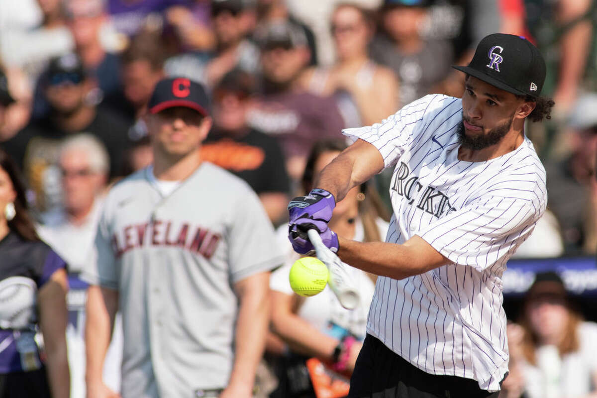 DENVER, COLORADO - JULY 11: San Antonio Spurs Guard Derrick White during the MLB All-Star Celebrity Softball Game at Coors Field on July 11, 2021 in Denver, Colorado.
