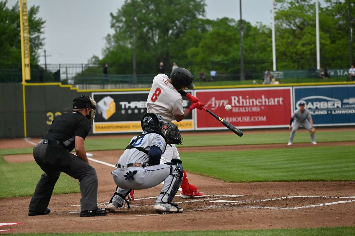 Great Lakes Loons' Leonel Valera makes contact during a June 2, 2021 game against the West Michigan Whitecaps at Dow Diamond.