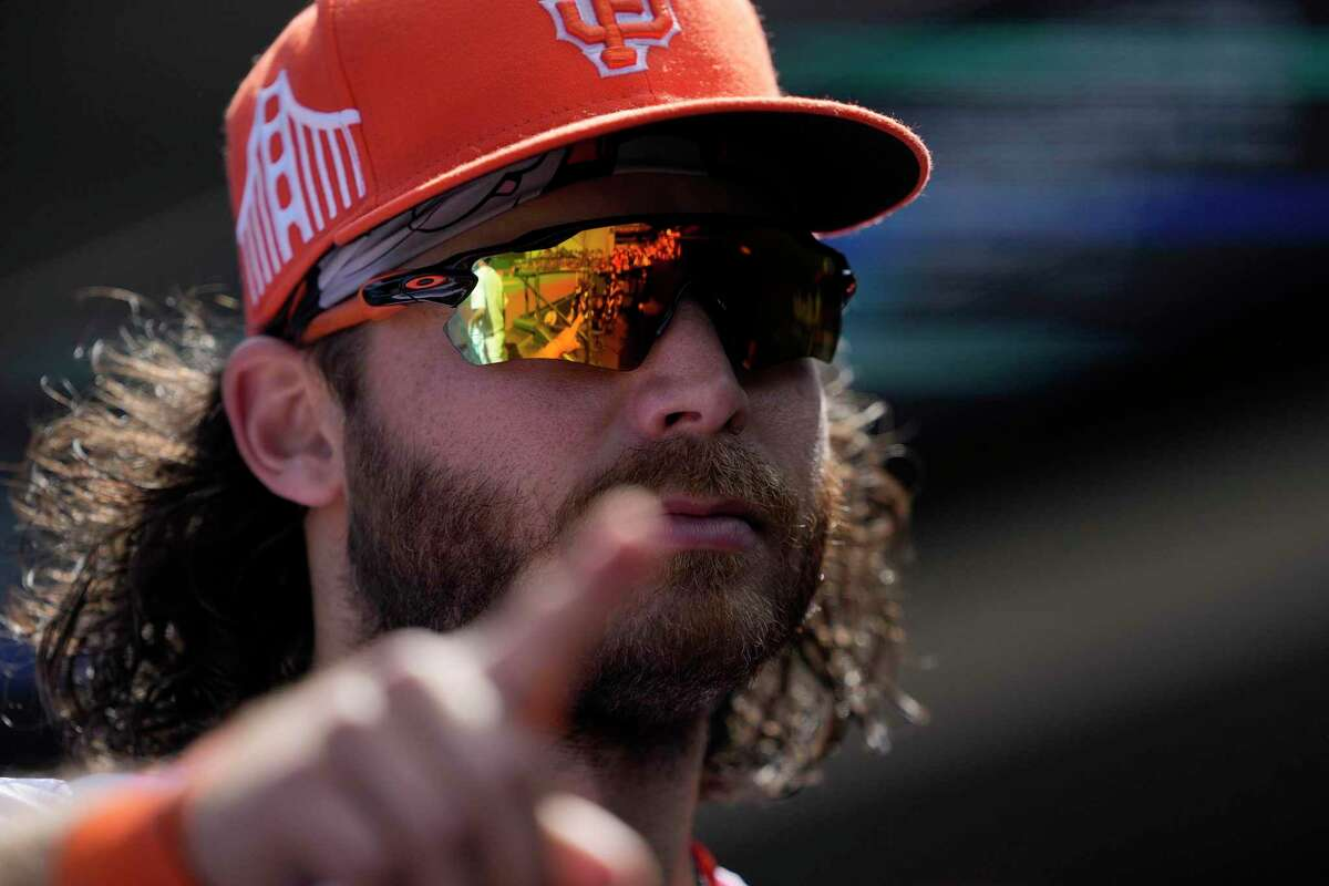 San Francisco Giants shortstop Brandon Crawford points to fans as he walks into the dugout after a victory over the Washington Nationals in a baseball game Sunday, July 11, 2021, in San Francisco. (AP Photo/Tony Avelar)