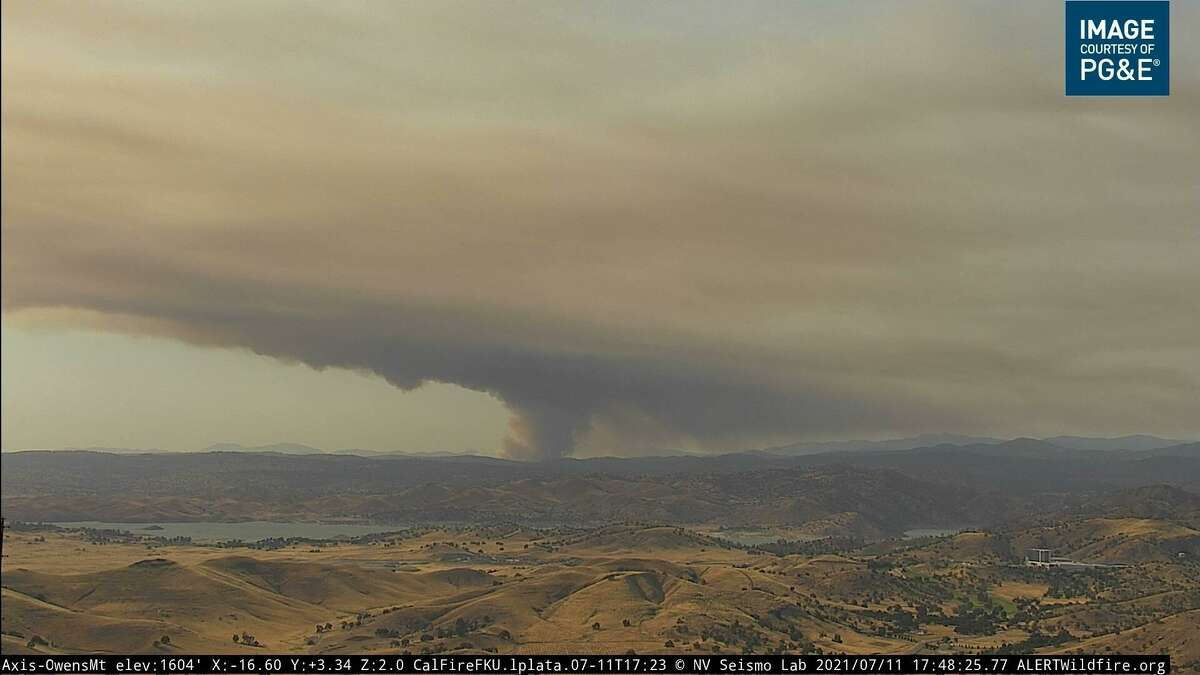 An image from a wildfire camera showing smoke billowing off of the River Fire burning across swaths of Mariposa and Madera counties.