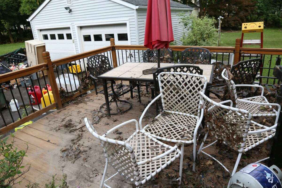 Sewage-soaked debris covers the back patio at the Valentine's Crimmins Road home, where water levels reached so high that they covered the garage doors on Friday morning.