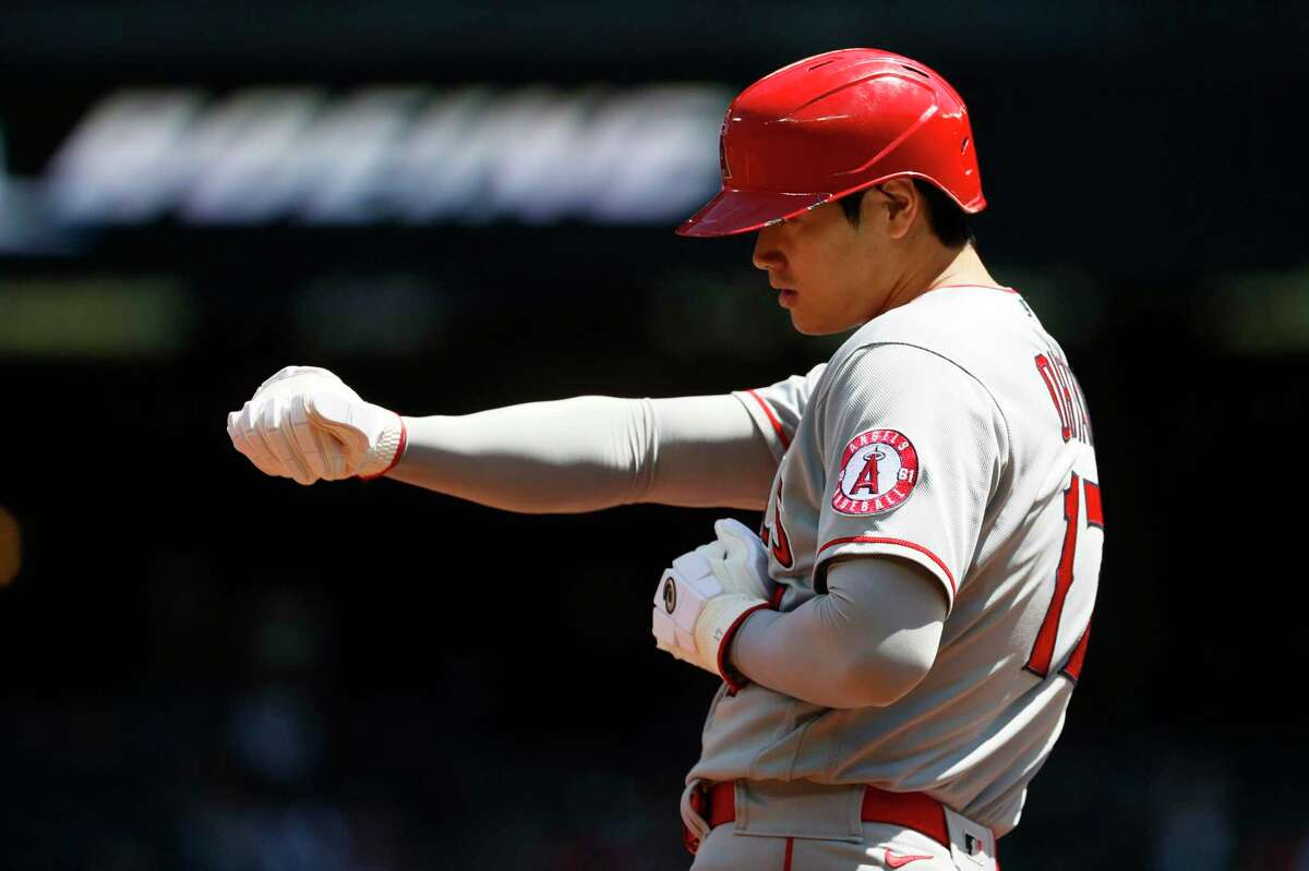 SEATTLE, WASHINGTON - JULY 11: Shohei Ohtani #17 of the Los Angeles Angels reacts after reaching third base against the Seattle Mariners during the first inning at T-Mobile Park on July 11, 2021 in Seattle, Washington. (Photo by Steph Chambers/Getty Images)