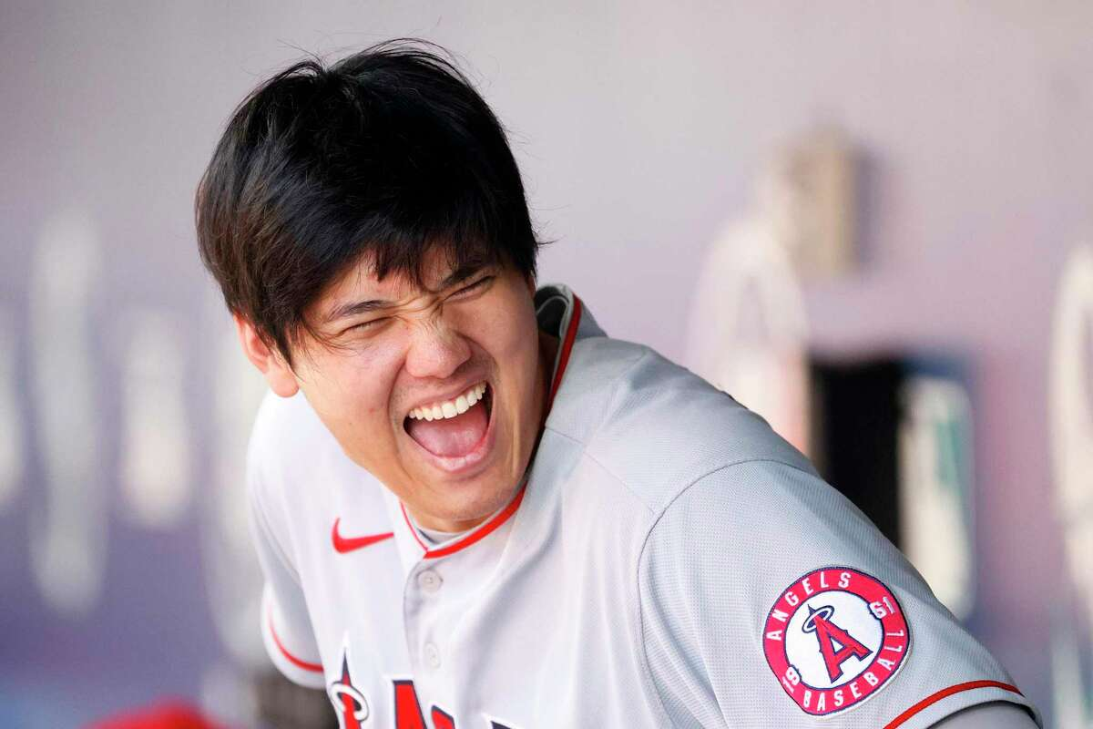 SEATTLE, WASHINGTON - JULY 11: Shohei Ohtani #17 of the Los Angeles Angels laughs in the dugout during the game against the Seattle Mariners at T-Mobile Park on July 11, 2021 in Seattle, Washington. (Photo by Steph Chambers/Getty Images)