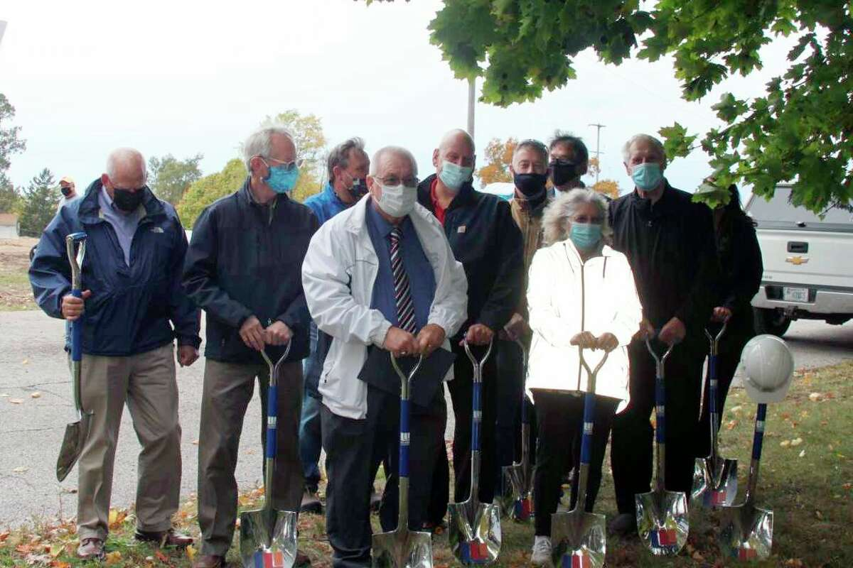 (Front left) Manistee Mayor Roger Zielinski is shown with Manistee City Council members and others for the Hollander Development Corporation and Little River Holdings' groundbreaking ceremony for Hillcrest Apartments in October. (File photo)