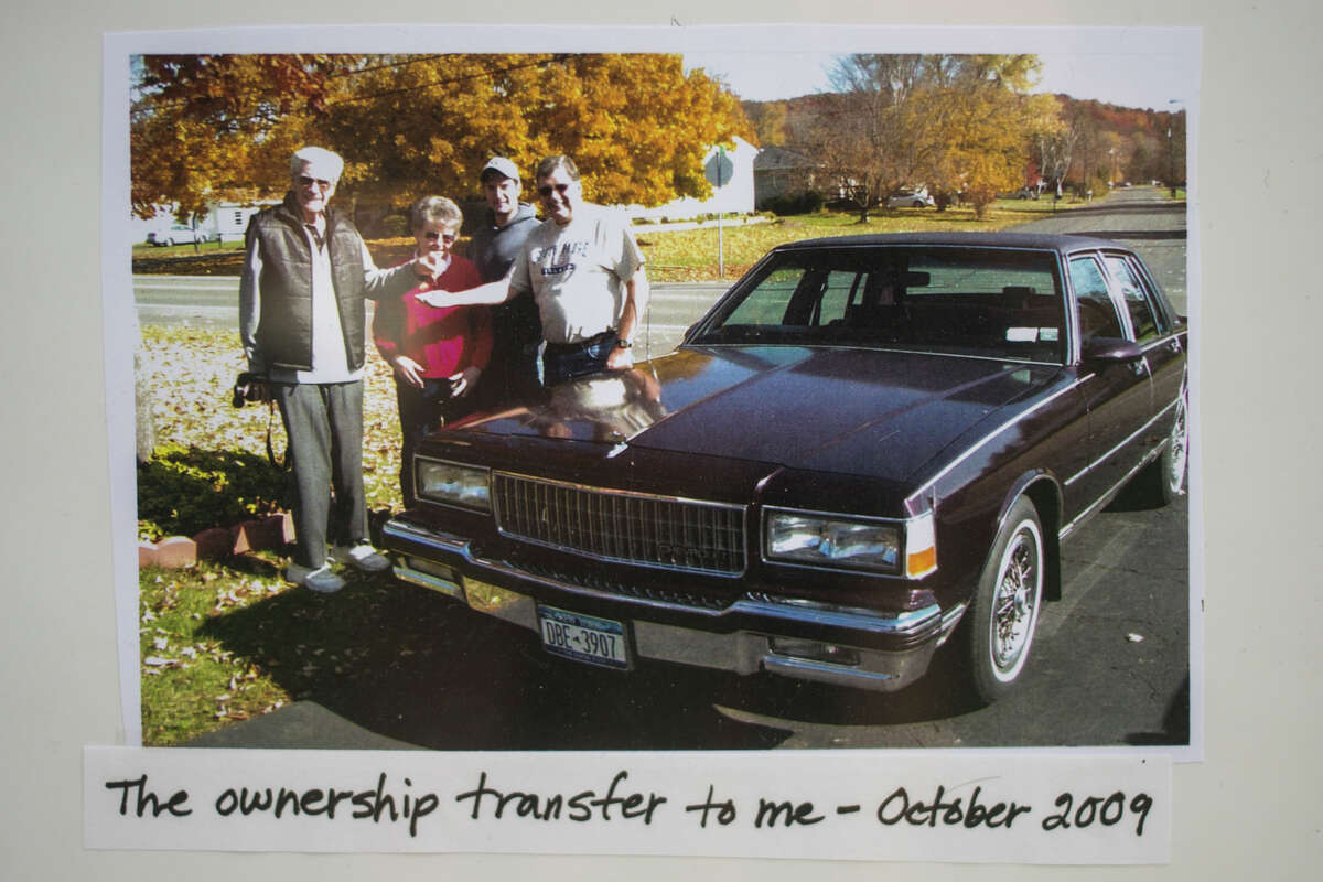 A photo shows the transfer of ownership of a Chevrolet Caprice Classic Brougham from Vert and Elizabeth Blanchard, left, to their son, Charlie Blanchard of Midland, right, in October of 2009. Charlie and his wife Connie restored the vehicle and showed the it in the Back to the Bricks Promo Tour in early June. (Katy Kildee/kkildee@mdn.net)