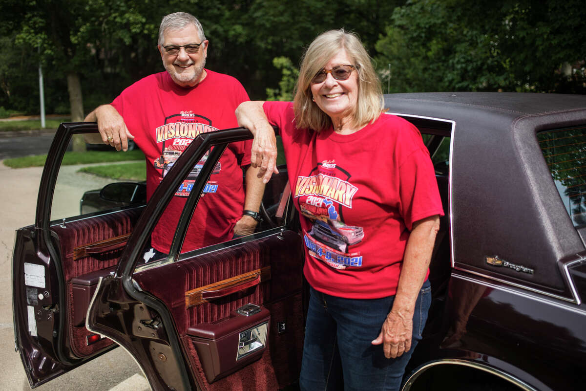 Charlie and Connie Blanchard pose for a portrait Monday, July 12, 2021 next to the Chevrolet Caprice Classic Brougham purchased in 1989 by Charlie's parents, Vert and Elizabeth Blanchard, which the couple restored and showed in the Back to the Bricks Promo Tour in early June. (Katy Kildee/kkildee@mdn.net)