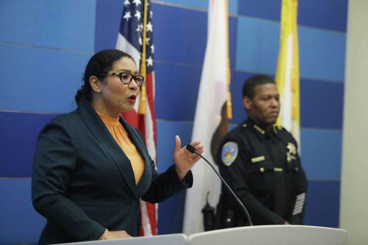 San Francisco Mayor London Breed (l to r) speaks during a press conference as and San Francisco Police Chief Bill Scott listens before speaking on a mid-year report on public safety statistics on Monday, July 12, 2021 in San Francisco, Calif.
