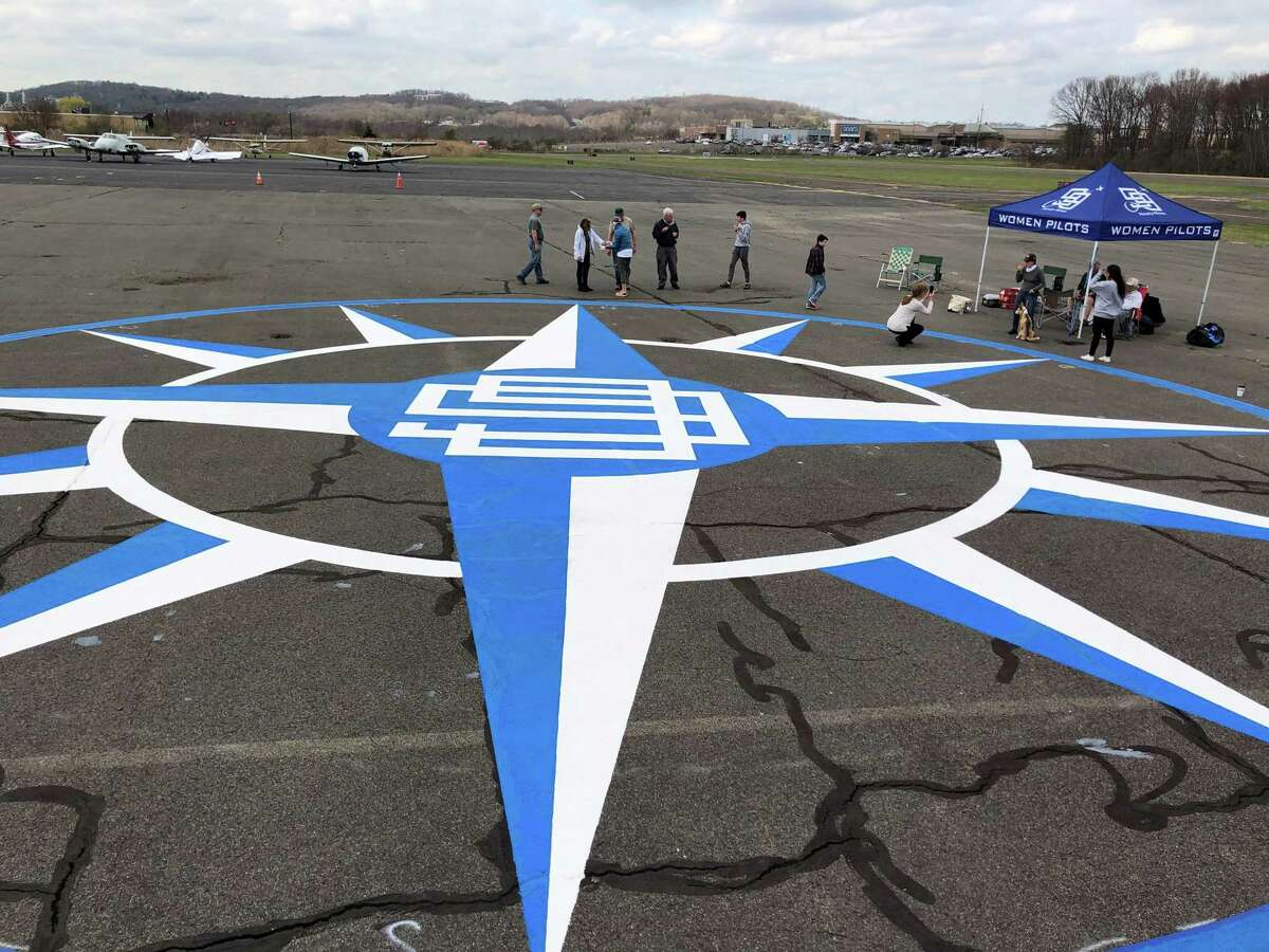 Danbury teen Jake Windas organized the painting of a compass rose in April 2021 at Danbury Municipal Airport for his Eagle Scout project.
