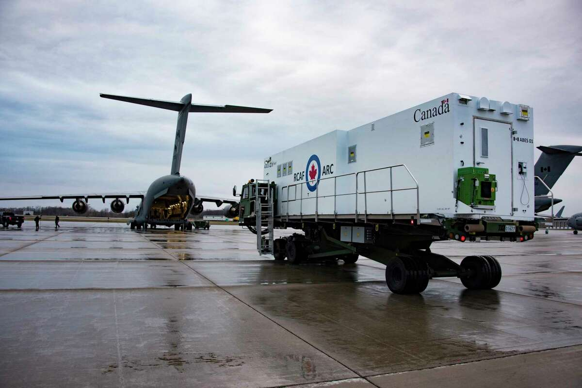 An Aeromedical Biocontainment Evacuation System is loaded on a Canadian Armed Forces CC-117 Globemaster in April in preparation for its firs mission. Knight Aerospace at Port San Antonio builds these special medical modules for aircraft.