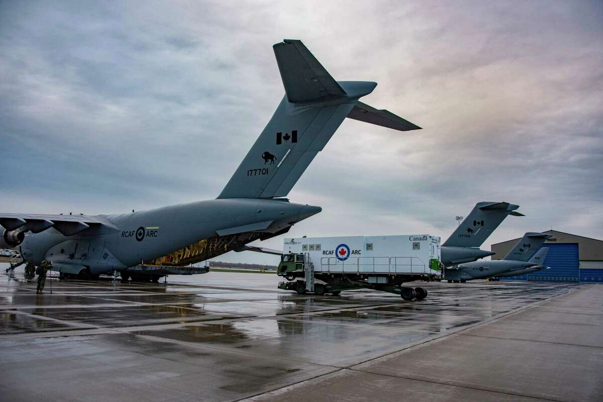 An Aeromedical Biocontainment Evacuation System (ABES) is loaded on a Canadian Armed Forces CC-117 Globemaster at 8 Wing, Trenton, Ontario on April 11, 2021 in preparation for its first mission. Knight Aerospace at Port San Antonio builds these special medical modules for aircraft.