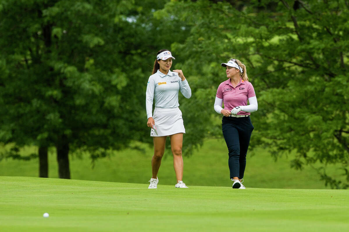 LPGA players In Gee Chun of South Korea, left, and her playing partner Brooke Henderson of Canada, right, play a practice round Monday, July 12, 2021 ahead of the Dow Great Lakes Bay Invitational at the Midland Country Club. (Katy Kildee/kkildee@mdn.net)