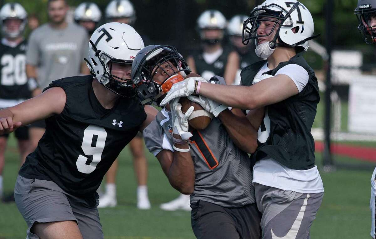 Stamford's Jash Bhandari (1) makes a reception in traffic during the Grip It and Rip It football tournament on Friday in New Canaan.