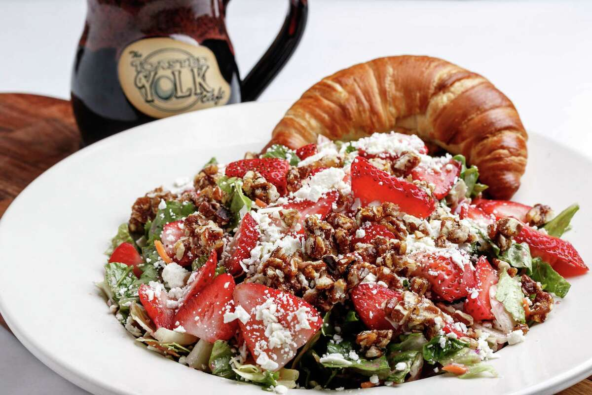 """The Toasted Yolk Cafe's Strawberry Field Salad is """"Mixed greens, grilled chicken, strawberries, feta, candied pecans. Served with blackberry vinaigrette."""""""