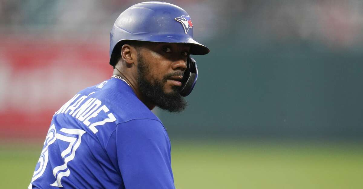 Toronto Blue Jays' Teoscar Hernandez looks on after sliding back to first base against the Baltimore Orioles during the fourth inning of a baseball game, Tuesday, July 6, 2021, in Baltimore. (AP Photo/Julio Cortez)