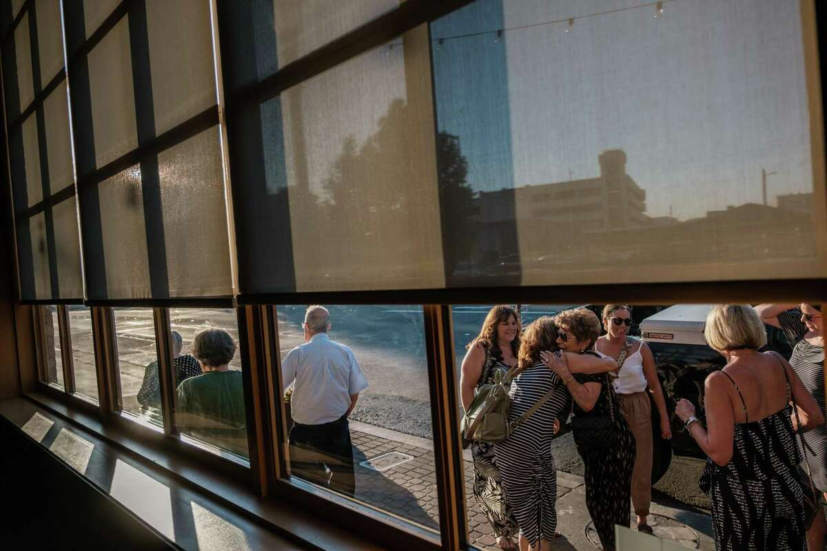 Friends say goodbye after exiting a restaurant in downtown Walnut Creek.