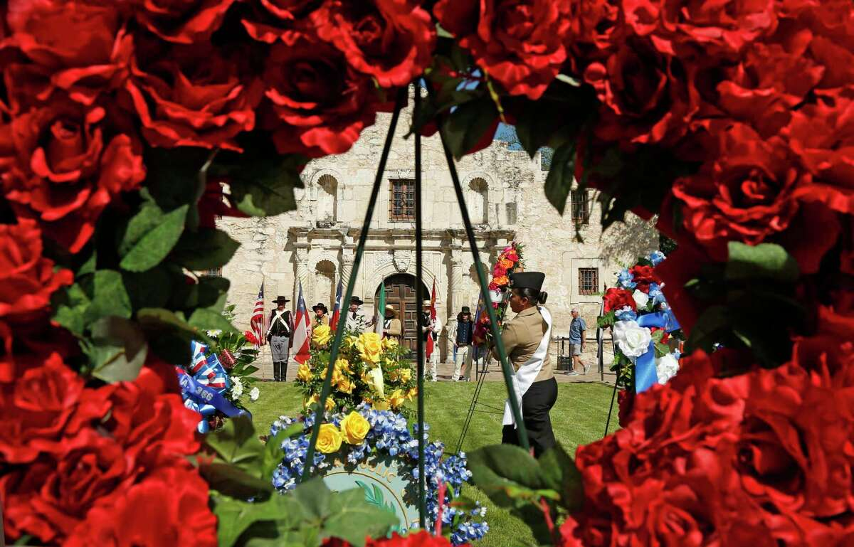 The wreath-bearing procession at the Alamo features historic, civic, military and school groupsand a roll call of the Alamo battle dead is read on Monday, April 23, 2018.
