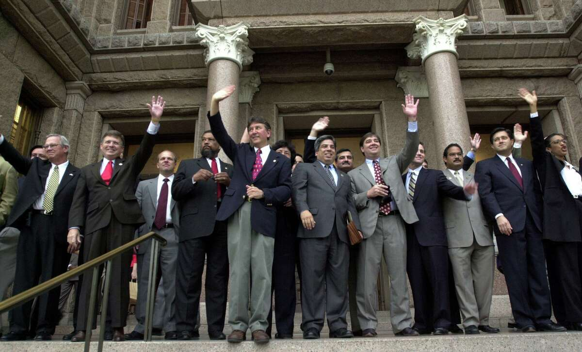 Texas House Democrats wave to supporters gathered on the south steps of the Capitol in Austin, Texas Friday, May 16, 2003. The Democrats, who have been in Oklahoma since Monday in order to prevent quorum in the House and stop a controversial redistricting bill, were welcomed home after their arrival early Friday morning. (AP Photo/Kelly West)