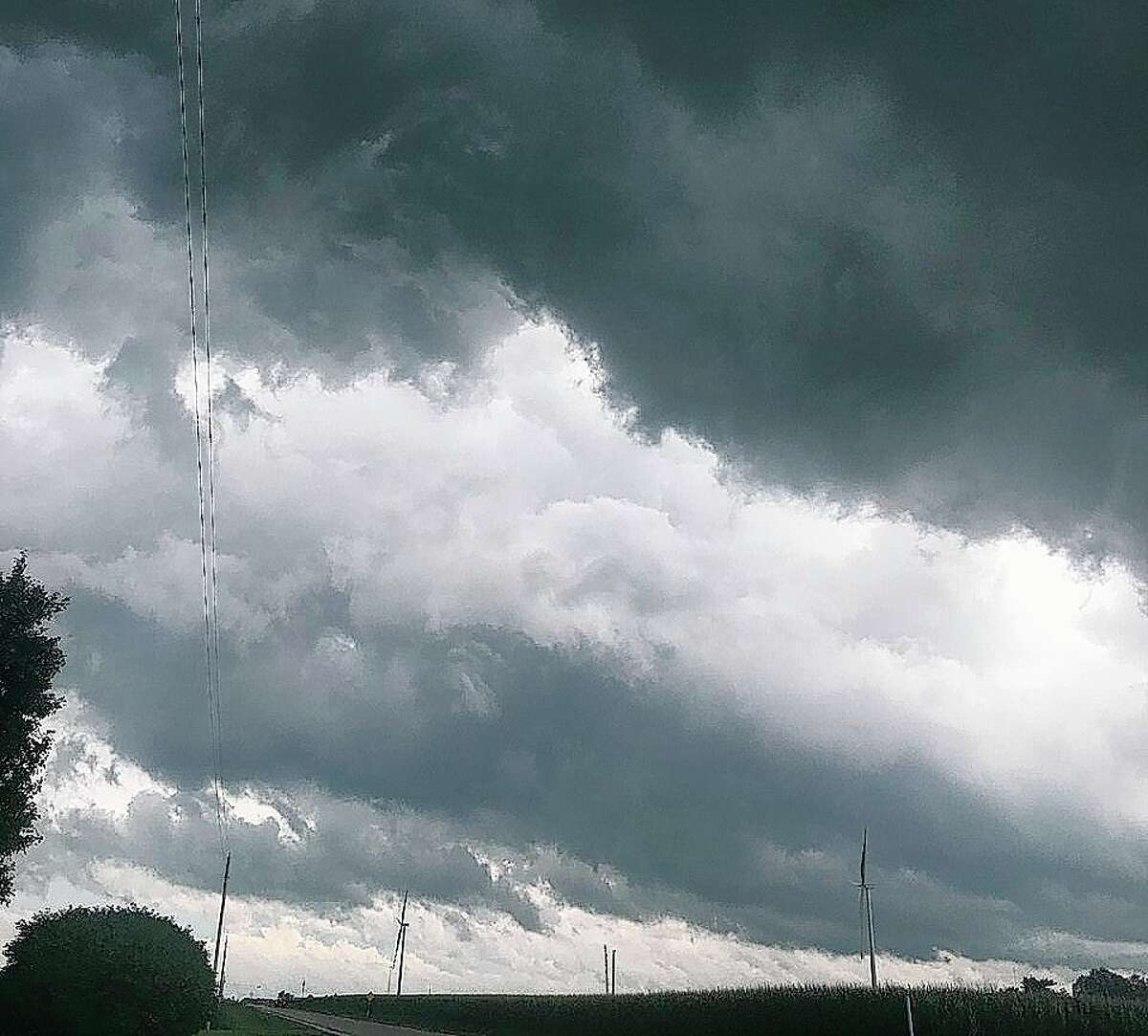 Ominous clouds roll through rural Alexander on Saturday just minutes after tornado warning was issued.