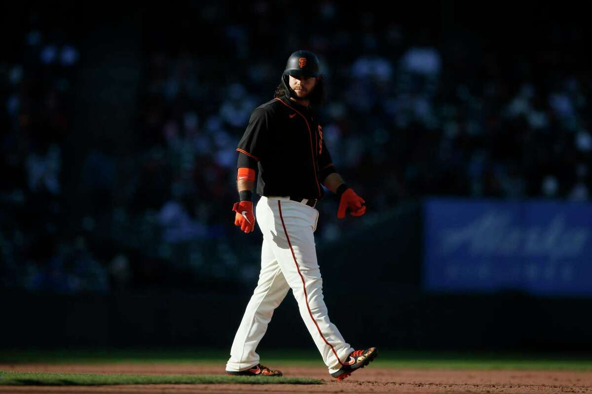 The San Francisco Giants' Brandon Crawford (35) at second base during the Giants' at-bat in the seventh inning during an MLB game against the Los Angeles Dodgers at Oracle Park, Saturday, May 22, 2021, in San Francisco, Calif.