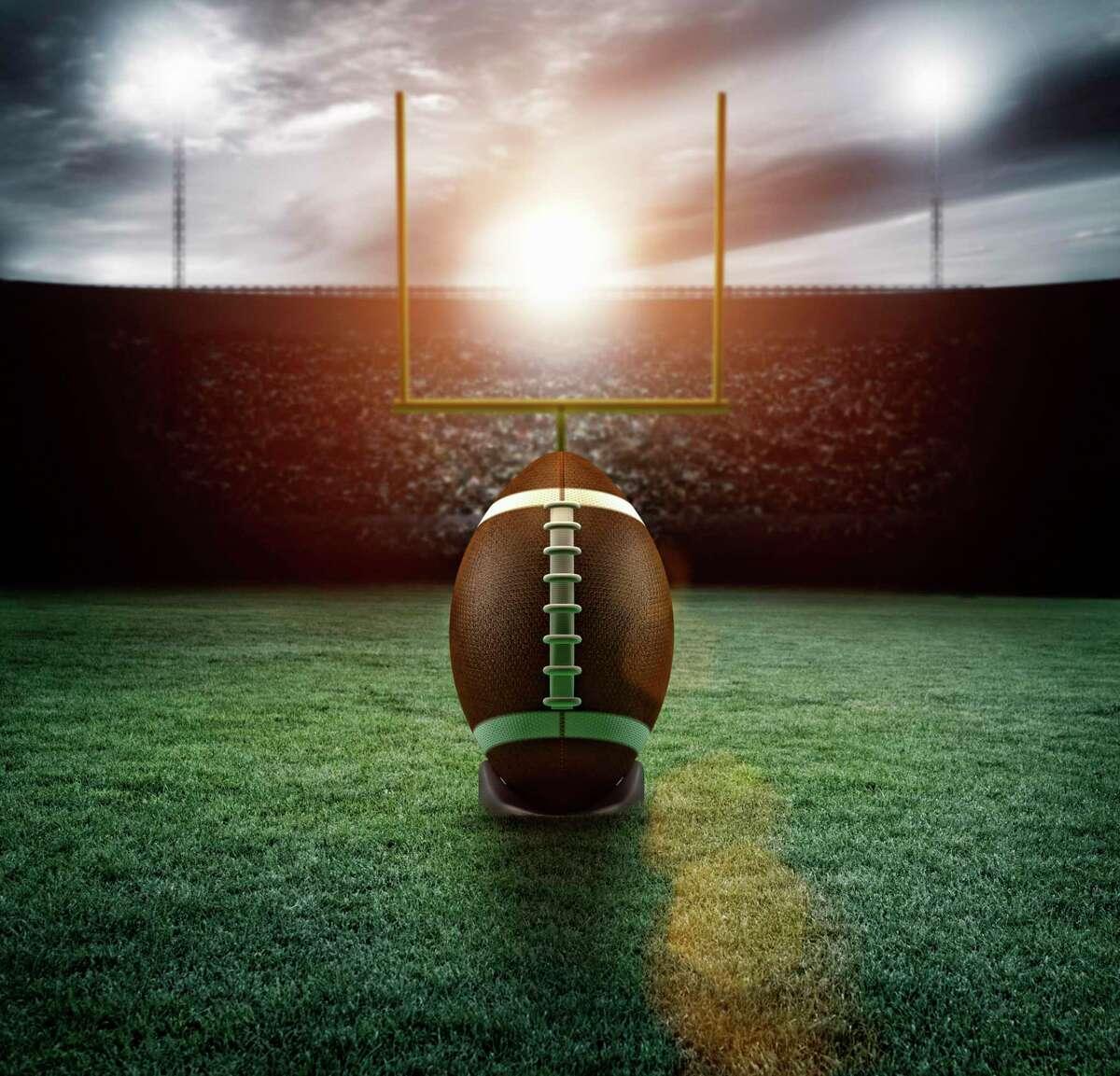 Football in stadium. Stock photo