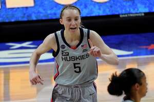 Connecticut guard Paige Bueckers (5) reacts after making a basket during the first half of a women's Final Four NCAA college basketball tournament semifinal game against Arizona Friday, April 2, 2021, at the Alamodome in San Antonio. (AP Photo/Eric Gay)