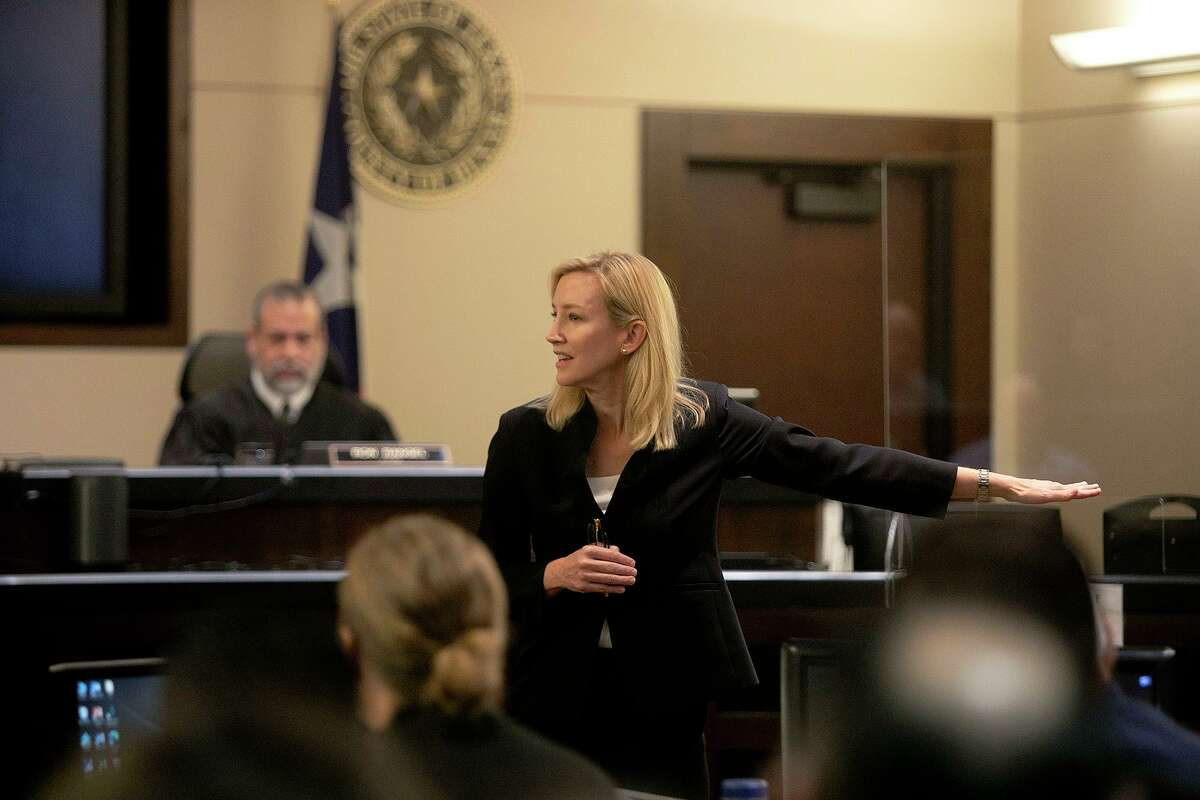 As she speaks to the jury, prosecutor Tamara Strauch motions toward defendant Otis McKane, not pictured, who is accused of killing San Antonio police Detective Benjamin Marconi, during her opening statement Monday.