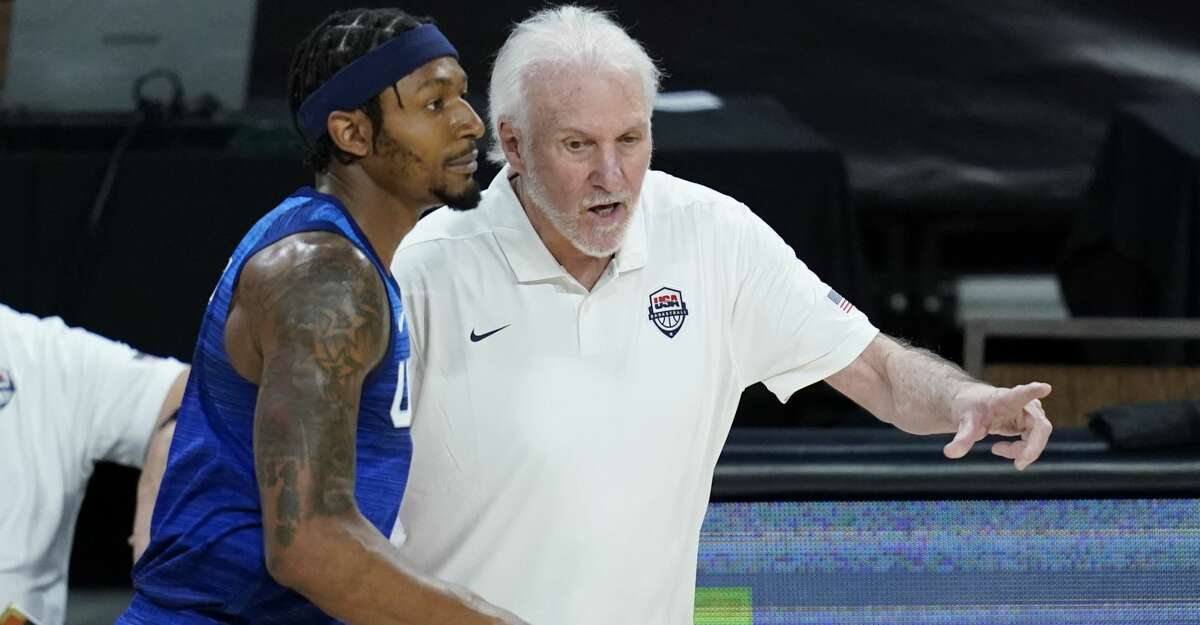 United States' head coach Gregg Popovich speaks with Bradley Beal during an exhibition basketball game against Australia, Monday, July 12, 2021, in Las Vegas. (AP Photo/John Locher)