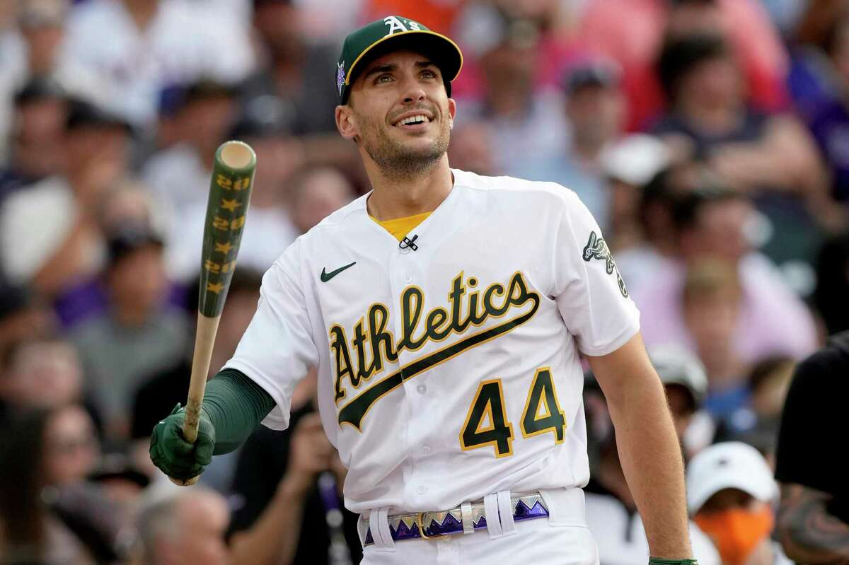 American League's Matt Olson, of the Oakland Athletics, watches his ball take flight during the first round of the MLB All Star baseball Home Run Derby, Monday, July 12, 2021, in Denver. (AP Photo/David Zalubowski)