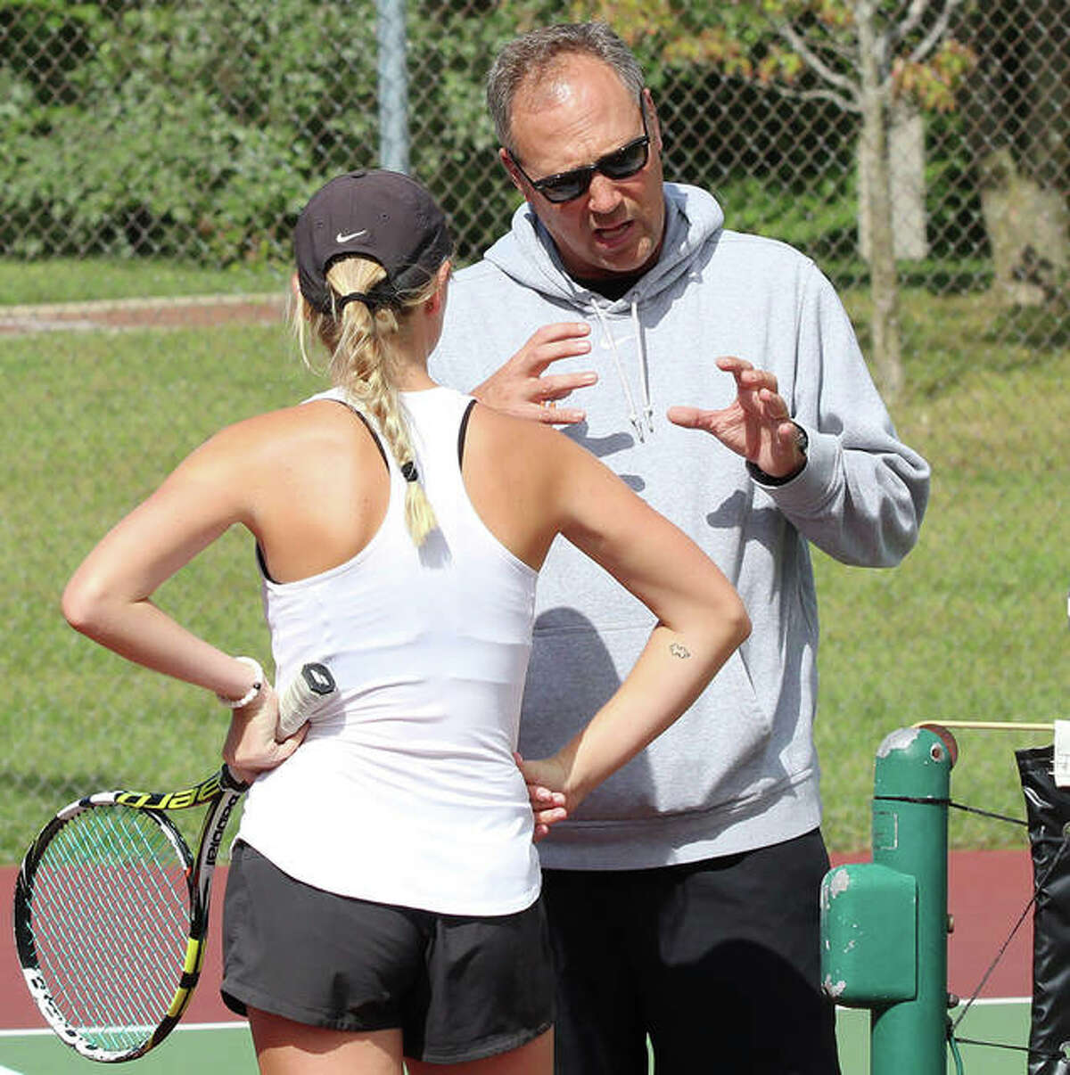 Edwardsville coach Dave Lipe (right), shown talking with Annie McGinnis during a break in a 2018 doubles match, is the 2020 Telegraph Girls Tennis Coach of the Year.